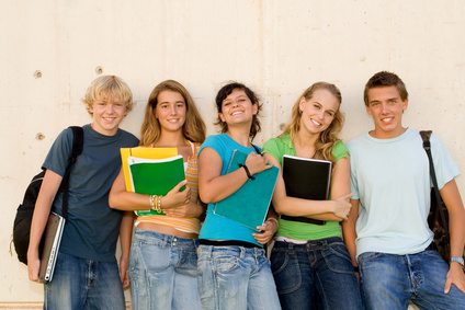group of teens students hanging out at school