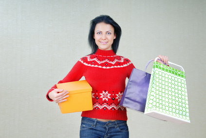 Photo of smiling lady with shopping packages and gifts