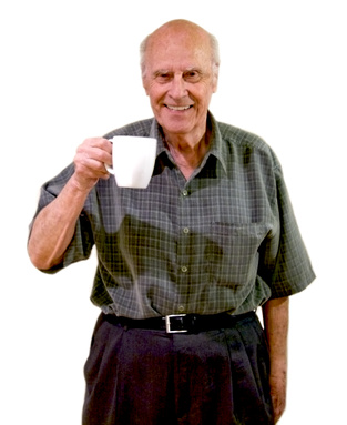 Senior smiling holding cup of coffee