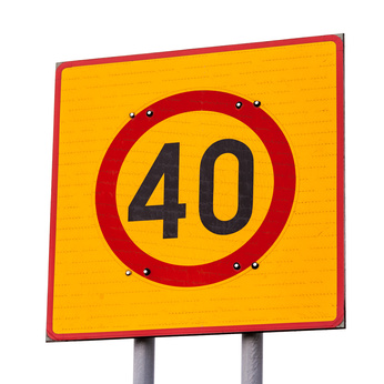 Speed limit road sign isolated on white