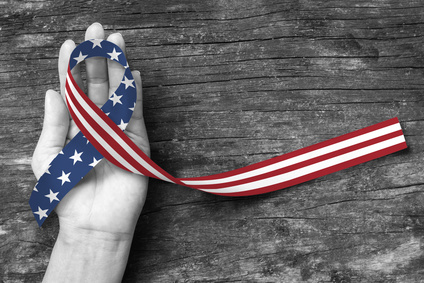 American flag pattern awareness ribbon color splashed on human hand grunge background: United states of america public holiday USA national day, nationalism raising US nation support campaign concept